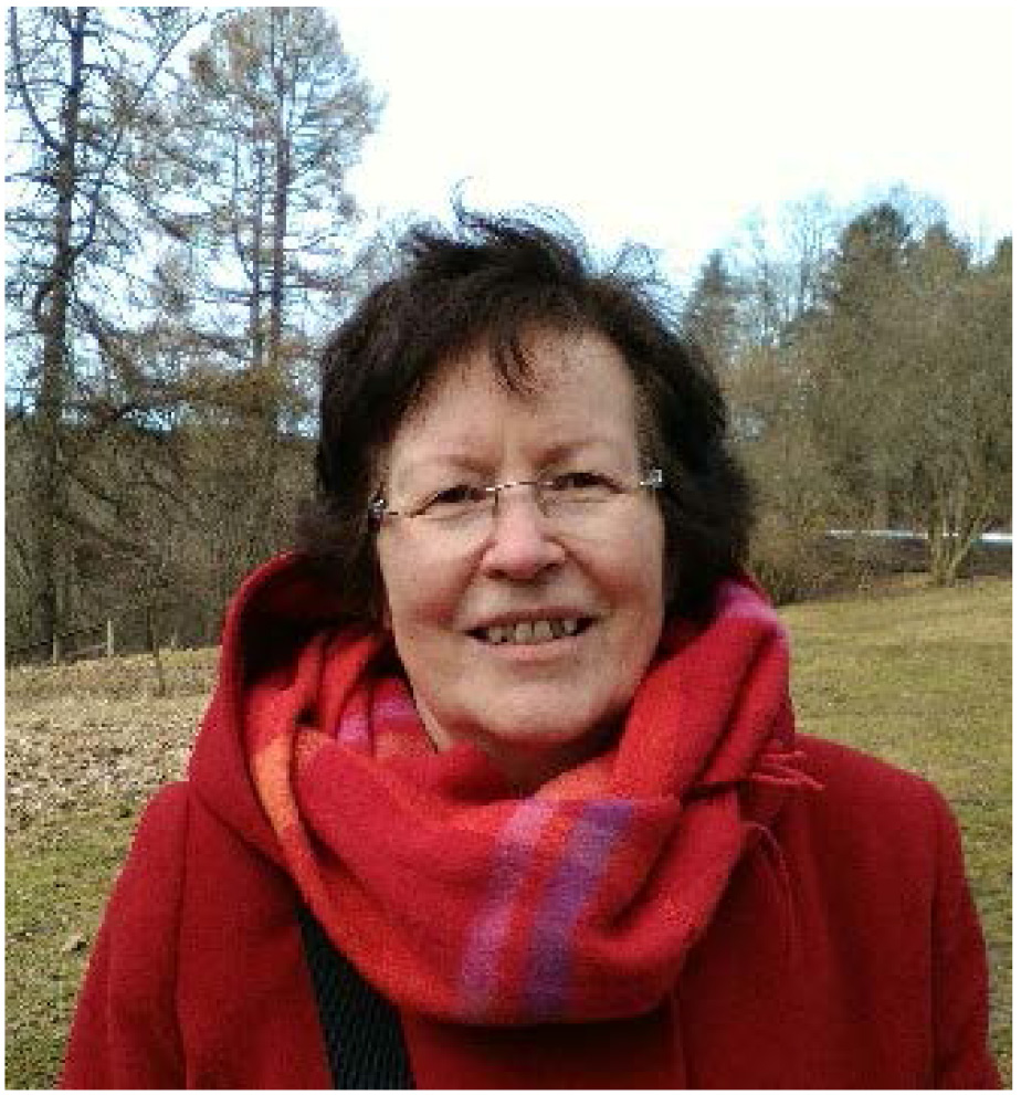 Official Statistics: Asta Manninen wearing red scarf and jacket in a meadow